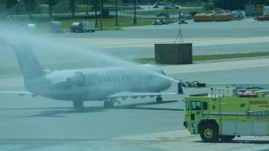 United Airlines flight gets water salute as first flight returns to MHT in over a year.
